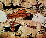 Mural of men on horses with bows and arrows shooting deer.