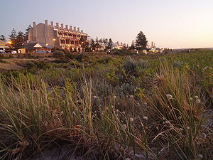 Grange, South Australia - Southeast-facing view of the historic Marine Apartments over the coastal sand dune north of Grange jetty