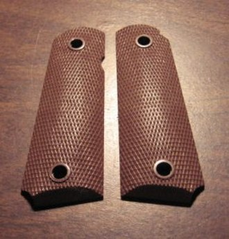 Gunsmith - Simulated checkering on plastic pistol grips.