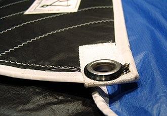 Cringle - A cringle at the corner of a sail.