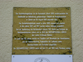 Historical report sign at the entrance of the former Naval School Luebeck.png