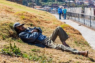 Sleep - Man napping in San Cristóbal, Peru.