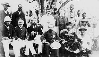 Kapitaï and Koba - King William Fernandez of Bramiah (front, second from right) with the future governor Jean-Marie Bayol around 1885.