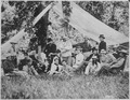 Hunting and camping party of Custer (standing in center) and invited guests. Fort A. Lincoln on the Little Heart River, - NARA - 530885.tif