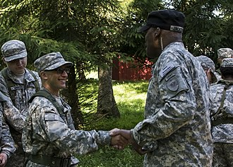 Indiana Guard Reserve - A member of the Indiana Guard Reserve shakes hands with a JROTC cadet during the JROTC Cadet Leaders Course at Camp Atterbury.