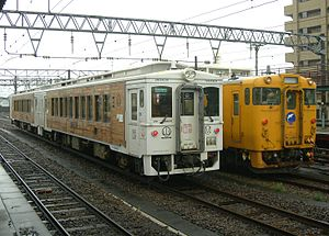Nichinan Line - Nichinan Line trainsets, with the Umisachi Yamasachi limited express on the left