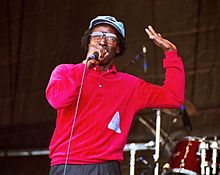 Adams performing at the 1997 New Orleans Jazz & Heritage Festival