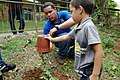 José Martinez helps a young boy plant an endangered tree at the Puerto Rico Zoo. (5756225224).jpg