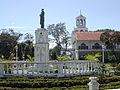 Jose Rizal statue with church in background Villa de Arevalo Iloilo.jpg