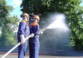 Fire fighting exercise carried out by youth fire fighters