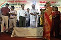 K.R. Periyakaruppan distributing financial aid under marriage assistance scheme to the people below the poverty line on the opening day of Bharat Nirman Public Information Campaign at Manamadurai in Sivaganga District.jpg