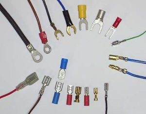 Electrical connector - Blade connectors (lower half of photo). Ring and spade terminals (upper half). Bullet terminals, male and female (right-center, with blue wires)