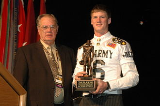 Mitch Mustain - Mustain receiving the annual Hall Trophy from high school football legend Kenneth Hall.