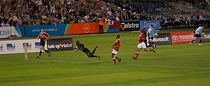 Rugby sevens - Kenya scores a try against Tonga during the 2006 Commonwealth Games