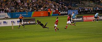 Rugby sevens - Kenya scores a try against Tonga during the 2006 Commonwealth Games.