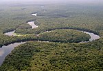 A river meandering through a wooded plain.