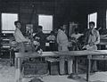 Lahainaluna seminary workshop, mechanical printing press and movable type in type case in background, ca. 1895.jpg