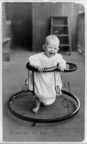 Baby walker - A baby in a baby walker, 1905