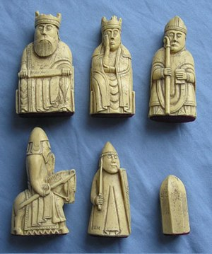 History of chess - Real-size resin reproductions of the 12th century Lewis chessmen. The top row shows king, queen, and bishop. The bottom row shows knight, rook, and pawn.