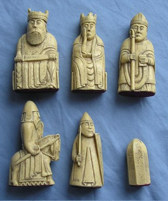 History of chess - Real-size resin reproductions of the 12th-century Lewis chessmen. The top row shows king, queen, and bishop. The bottom row shows knight, rook, and pawn.
