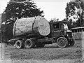 Leyland truck transporting a piece of Kauri (AM 75770-1).jpg