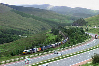 West Coast Main Line - The northern WCML as it weaves through the Lune Gorge in Cumbria alongside the M6 Motorway.