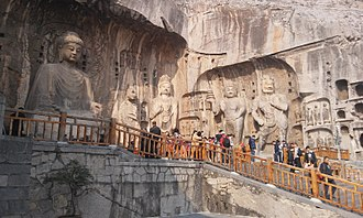 The Fengxian cave (circa 675 AD) of the Longmen Grottoes, commissioned by Wu Zetian. Luoyang longmen grottoes 2.jpg