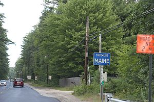 U.S. Route 302 - The state border sign for Maine on U.S. Route 302 in 2014