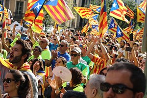National Day for Yes - People peacefully demonstrating in the streets of Barcelona hoisting Estelades, Catalan secessionist flags.