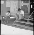 Manzanar Relocation Center, Manzanar, California. Evacuee boys of Japanese ancestry at entrance of . . . - NARA - 538075.tif