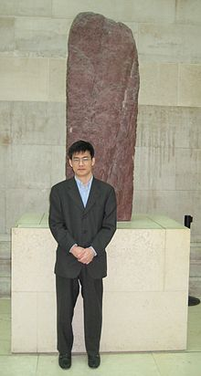 Marc Miyake and ogham stone at British Museum.jpg