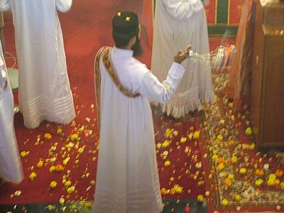 Flowers (in this instance marigolds) strewn about the sanctuary in an Oriental Orthodox church in Mumbai, India on Palm Sunday. Marigolds in the sanctuary.jpg