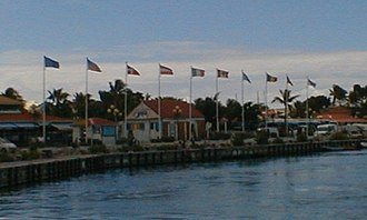 Saint Martin - Flags flying in Marigot harbor, Saint-Martin