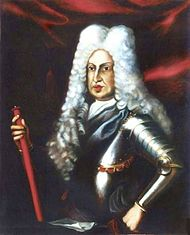 A corpulent man wears a powdered peri-wig with a black set of armour.