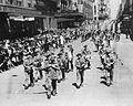 Members of the 2-19 Battalion marching down Castlereagh Street near the corner of Hunter Street in Sydney CBD during September 1940.jpg
