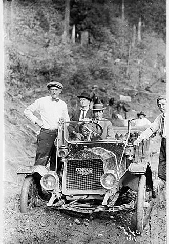 "Flanders Model ""20"" on a dirt road Men posed with Flanders automobile on Index-Galena road, 1911 (PICKETT 14).jpeg"