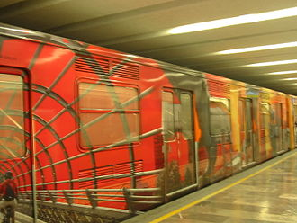 Mexico City Metro - Mexico City Metro train in Bellas Artes station, decorated with images related to the city.