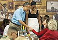Michelle and Barack Obama greet a family member, 2012.jpg