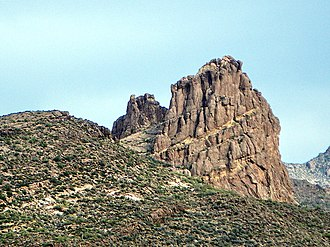 Superstition Mountains - Miners Needle from Bluff Spring Trail. Note prominent bedding planes in the volcanics.