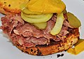 Mmm... corned beef on an onion roll (6147643989) (2).jpg