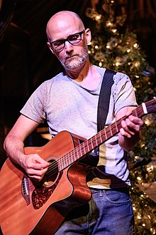 Moby playing his guitar in 2018