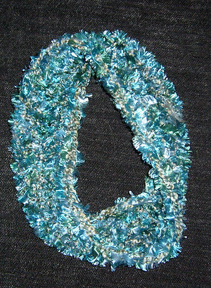 Stitch marker (crochet) - A demonstration of the mathematical basis of crochet: a scarf in the shape of a Möbius strip.