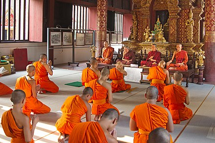 Buddhist monks in Thailand. Monks in Wat Phra Singh - Chiang Mai.jpg