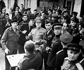 Order of Victory - British Field Marshal Bernard Montgomery (left, wearing beret) was awarded the Order of Victory on June 5, 1945.  American general Dwight Eisenhower and Soviet field marshal Georgy Zhukov, also recipients of the Order of Victory, are to the right of Montgomery.  British air marshal Sir Arthur Tedder (right of Zhukov) is also present.