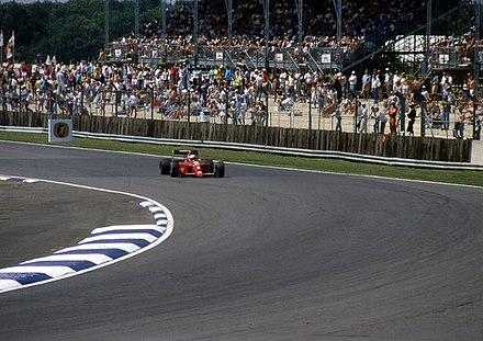 Former Formula One world champion Nigel Mansell driving at Silverstone in 1990. The circuit hosted the first ever Formula One race in 1950 Mr Mansell in his Fiat - geograph.org.uk - 1036315.jpg