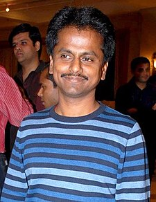 A picture of AR Murugadoss as he looks at the camera.