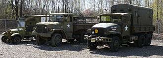 M35 series 2½-ton 6x6 cargo truck - M135 is to the right of M35