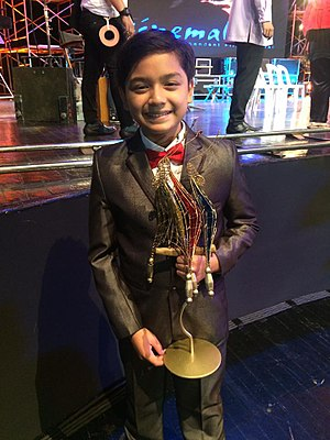 Noel Comia Jr. - Noel Comia Jr., with his award for Best Actor at Cinemalaya 2017