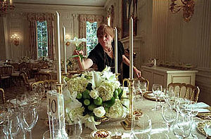 White House Chief Floral Designer - White House Chief Florist Nancy Clarke completes an arrangement of white lilies, white roses, hydrangea, and limes before a dinner in the State Dining Room.