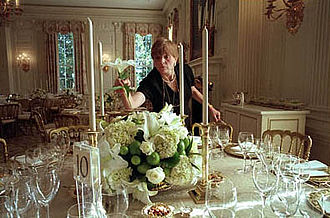 White House Chief Floral Designer - White House Chief Florist Nancy Clarke completes an arrangement of white lilies, white roses, hydrangeas, and limes before a dinner in the State Dining Room.
